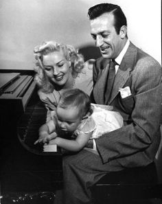 Betty Grable, Harry James, and daughter Vicky on piano.