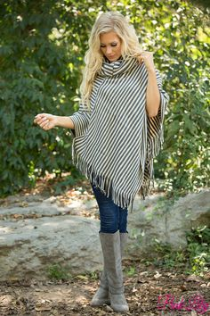 This beautiful earth toned fringe poncho is such a gorgeous way to rock neutrals this season!