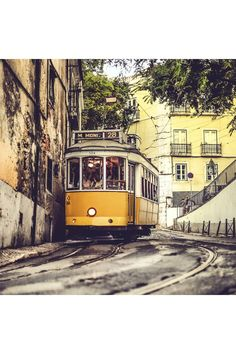 Lisbon Travel Guide: Spread across steep hills, Lisbon is a city brimming with culture, charm and beauty - perfect for a city break. Vogue's deputy editor Emily Sheffield shares her secrets to exploring the Portuguese capital in true Lisboan style. Anime Plus, Anime W, Lisbon Tram, Photo Voyage, Spain And Portugal, Belle Photo, Malta, Wonders Of The World, Travel Inspiration