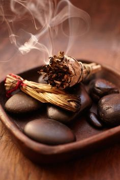"""A popular Native American technique for removing bad energy is lighting sage, then blowing out the flame. """"The smoke is what you will use to clear your home,"""" says Calamia. """"I always start at the front door and work my way around in clockwise direction."""" After """"smudging"""" the entire home, visualize your intentions for your home as the smoke filling every crevice."""