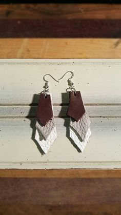 Check out this item in my Etsy shop https://www.etsy.com/listing/579110501/leather-earrings-elegant-leather-bar