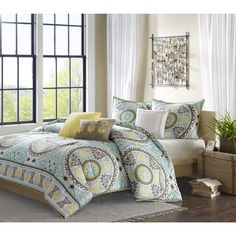 This 200 thread count cotton sateen duvet cover and shams feature dusty shades of green, teal, brown and yellow. The medallion motif repeats across the duvet cover and shows up centered on each sham while the dusty green continues on the reverse.