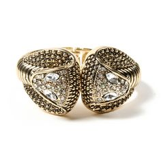 Two crystal cobra heads meet in the middle of this gold brass cuff to make a stylish statement.