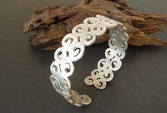 Caracoles Sterling silver bracelet by mimieme on Etsy, $105.00