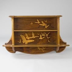 Gallé Marquetry Bookcase inlaid fruitwood marquetry depicting flying butterflies.  Mackolowe Gallery.