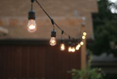 String lights in the back yard ... perfect for any time. These are commercial medium-based strings with suspenders: http://www.partylights.com/Commercial/Commercial-Medium-Strings-Bulbs