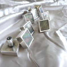 Cabinet handle in tarnished silver finish with black Mother of Pearl insert. Made to order.