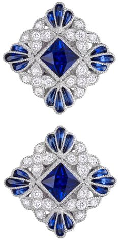 Lucie Campbell Square-Shaped Sapphire & Diamond Stud Earrings.     Square-shaped sapphire and diamond stud earrings, centering on a larger square-cut sapphire surrounded by circular-cut diamonds and calibre-cut sapphires, the sapphires weighing approximately 1.03 total carats and diamonds weighing approximately 0.29 total carats, mounted in 18k white gold, with posts and friction backs, designed by Lucie Campbell.