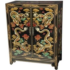 Crafted by and imported from a small family owned workshop in Guangdong, this stunning cabinet is hand painted with an elaborate Chinese dragon design. Finished with a rich lacquer finish both inside and out, and featuring a removable interior shelf, this cabinet provides both a practical storage solution and a unique Oriental accent for the home