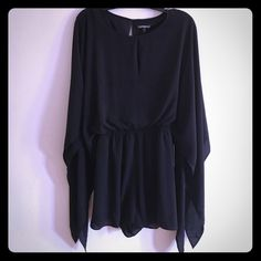 Express Romper Brand new with tags romper. Size XS. Very cute. Great for summer. All black. Express Other