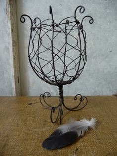 handmade wire footed basket or chalice. $42.00 USD, via Etsy.