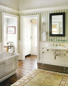 thefoodogatemyhomework: Spectacular country house bathroom with Waterworks tub and sink. Gorgeous plank floors and striped walls. Love how the lucite legs on the sink console give a perfect contemporary kick to this very traditional space. Garage Bathroom, Laundry In Bathroom, Bathroom Sinks, Striped Wallpaper Bathroom, Stripe Wallpaper, Wallpaper Ideas, Beautiful Bathrooms, Modern Bathroom, Striped Walls