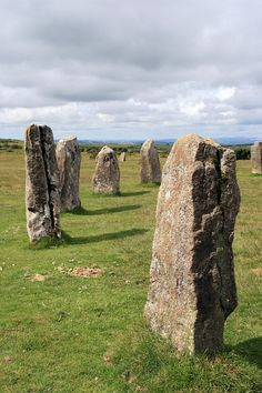 Located in the scenic landscape of Bodmin Moor in Cornwall, the Hurlers date from about 1500 BC. They consist of three stone circles in a row and are named for a medieval legend that they are men turned to stone for hurling (a Celtic game) on Sunday. St Just, Site Archéologique, Turn To Stone, Mystique, Cornwall England, Dartmoor, Cairns, Ancient Civilizations, British Isles