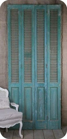 Old shutters ... with a few hinges what a great room divider