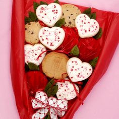 Imagine the surprise on someone's face when they open the long white box to find a delicious assortment of twelve extra large buttercream iced heart cutouts and gourmet cookies on long stems cradled in fern and baby's breath and tied with a bow.  This gift will surely be remembered! Cookie assortment includes: chocolate chip, oatmeal raisin, sugar, peanut butter, M&M, white chocolate chip pecan and iced buttercream cookies.