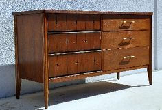 Vintage Mid Century Modern / Danish Modern Style / American Modern 6 Drawer Double Dresser Saga Collection by Broyhill Dates form the Late 1950s - Early 1960sOne of Broyhill\'s Rarest Sets of the Mid Century Modern AgeDistinctive Atomic Era Star Pattern on the Front Facade Makes this Dresser All the More Desirable for Retro Collectors. Can be Used as a Dresser or Credenza. Would Also Work Well as an Entertainment Center with a Flat Screen HDTV on Top and Storage for Media in the DrawersThe…