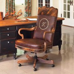 They've earned it, a chair all their own. Personalize this chair with a single initial encircled with a barbed wire motif embroidered on seat back. Solid maple frame with burnished leather seat, hair on hide seat deck and top yoke, and antique brass nail trim.