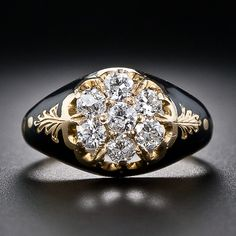 Victorian Diamond and Enamel Cluster Ring A rare, and original antique diamond ring, circa 1875. A sparkling cluster of seven bright-white old mine-cut diamonds, together weighing about one-half carat, sizzles from atop a lovely 12 karat gold mounting adorned with dramatic and striking black enamel. Consummate Victoriana. Due to the beautiful enamel work, this ring can not be re-sized.