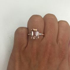 Emerald Cut Morganite and Baguette Three Stone Engagement Ring - click to enlarge More