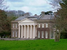Trelissick House in Cornwall is a National Trust property that includes Feature Radiators' exclusive Etonian cast iron radiators.