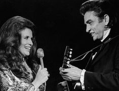 OLD TIMEY MUSIC ~ June Carter Cash and Johnny Cash. I'm not afraid of a banjo or a mandolin, and I am partial to fiddle. My father loved his Johnny Cash and Marty Robbins albums, which I also enjoyed as a girl and teenager.