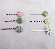 tutorial to make these out of bobbi pins with pads, decorative brads & hot glue (7 out of 10 Becca rating)