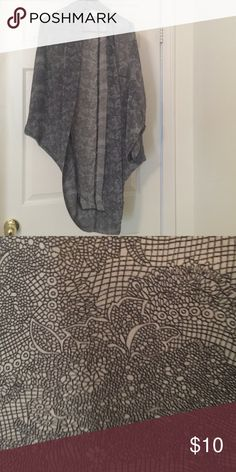 Grey shrug Lightweight shrug.  100% polyester *will bundle with any other item in my shop.  *prices are negotiable at a reasonable offer *smoke free house *no stains *ships out next day Cotton On Sweaters Shrugs & Ponchos
