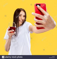 Stock Photo - Beautiful female half-length portrait isolated on yellow studio background. Young smiling woman with glass of red wine making selfie. Facial Expressions, Trendy Colors, Wine Making, Red Wine, Vectors, Beautiful Women, Concept, Stock Photos, Selfie