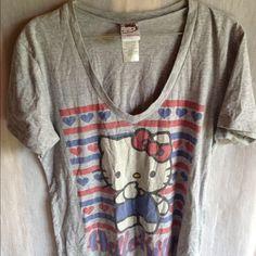 Grey Hello Kitty V Neck T shirt Grey V Neck Hello Kitty shirt. 60% cotton/40% polyester Tops Tees - Short Sleeve