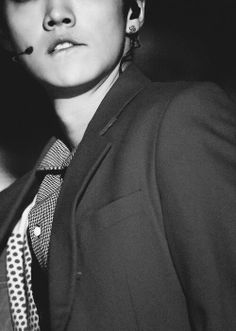 EXO - Luhan. Oh he just did it! He is biting his lip! Thats it! Im dead.