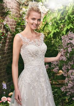 A-line gown features illusion neckline with lace appliqués and embellished with Swarovski Crystals | Rebecca Ingram | Alexis | http://knot.ly/649081oZA