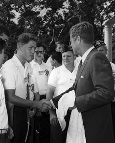 A young Bill Clinton meets President Kennedy 1963