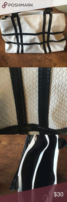 White and black snakeskin handbag White leather snakeskin with black leather quilting. Has never been used and comes with a shoulder strap as well. Bags Shoulder Bags