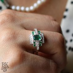 One of those moments when you see a ring and drop everything you are doing to go take a picture This Art Deco inspired 14k white gold ring by @beverleykcollection centers a gorgeous 0.53ct emerald cut emerald accented by 20 round diamonds and 4 French cut emeralds – sku: 200-08968 – listed online for $2960