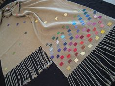 """You only see the pattern on one side of the fabric. It measures 19 1/2"""" by 110"""", including a 8"""" fringe at each end."""