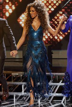 What a disco diva! Nicole Scherzinger opted for huge hair and a very low-cut dress for Disco Week on The X Factor on Saturday night