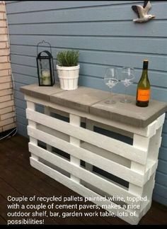 Pallets painted (I would use a dry brush technique with turquoise or a brick red) and topped with pavers.  Great for outdoor bar!!!