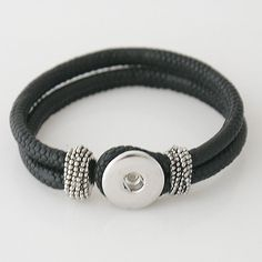 "Fits an 7.5"" wrist. Material: Faux Leather and Alloy"