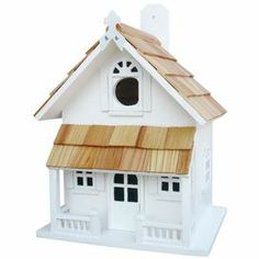 "This lovely cottage-style birdhouse offers feathered friends a charming retreat—the classic silhouette showcases a shingled pine roof and crisp white detail.      Product: Birdhouse Construction Material: Exterior grade ply-board, kiln dried hardwoods, and outdoor non-toxic paint Color: White and natural Features:  Removable back walls for easy cleaning, ventilation and drainage Unpainted interiors 1.25"" Hole openings designed to accommodate common cavity dwellers Dimensions: 10"" …"