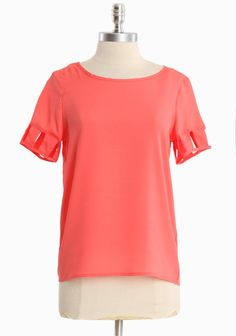"Astrid Cutout Sleeve Top 28.99 at shopruche.com. Cutout detail imparts a playful style to this cheerful tangerine colored top designed in delicate chiffon.  100% Polyester, Imported, 23.5"" length from top of shoulder"