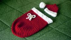 Newborn Christmas cocoon and matching Santa hat crocheted in Deborah Norville Serenity and Bernat Pipsqueak yarn.  Pattern from Leisure Arts booklet Crochet Cocoons (not a free pattern).