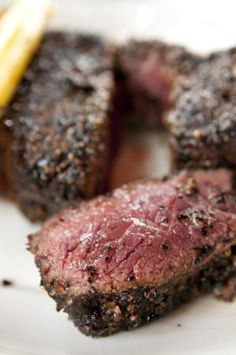 Grilled Coffee-rubbed Steak with Black Pepper and Coriander - Ground coffee adds a nice complex flavor to meats, especially beef. This grilled coffee-rubbed steak has great bold flavor that pairs very well with roasted vegetables. Pork Rib Recipes, Steak Recipes, Grilling Recipes, Cooking Recipes, Steaks, Ostrich Meat, Hunger, Bbq Pork Ribs, Grilled Meat