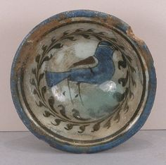Bowl Date: 12th–13th century Geography: Syria, Raqqa Culture: Islamic Medium: Stonepaste; painted on an opaque white ground under transparent glaze