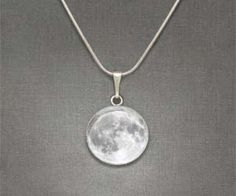 Enjoy a full moon no matter what stage of the lunar cycle we're on with this moon necklace pendant. These hand crafted moon pendants are seated in solid metal plates, giving it a durable finish so you can moon people for years and years.