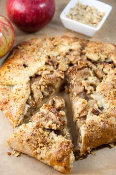 Apple Walnut Crostata An easy free form apple pie topped with walnuts! Serve with vanilla icecream and a drizzle of caramel sauce for the perfect Fall dessert!