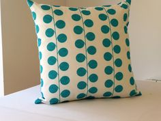 Contemorary Design decorative throw pillow, teal berry spots on a white background slip cover accent pillow. £15.90, via Etsy.