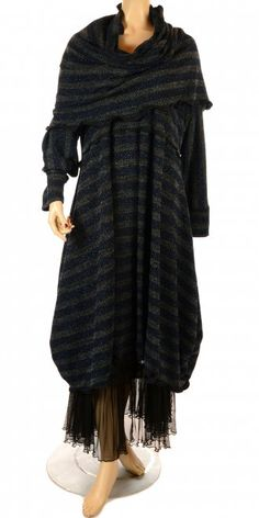 Exclusive collection only at idaretobe.com.     Two-in-one Dress with separate collar piece.     Winter knit fabric in black/grey and blue sparkle.     Scallop taffeta edging. Visit our webstore www.idaretobe.com