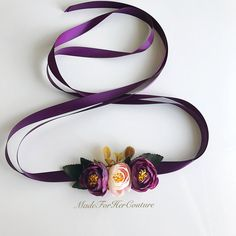 Plum flower sash, purple flower sash, flower sash, flower belt, bridal purple sash, wedding purple flower sash, wedding sash belt A beautiful handmade flower sash consisting of purple/plum and ivory with pink tone tea roses on a plum color satin ribbon. This sash is perfect for