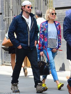 Coming up roses: Bradley Cooper and Sienna Millerlooked in fine spirits as they enjoyed a...