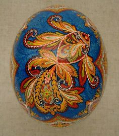 blue and gold painted Easter egg. fish